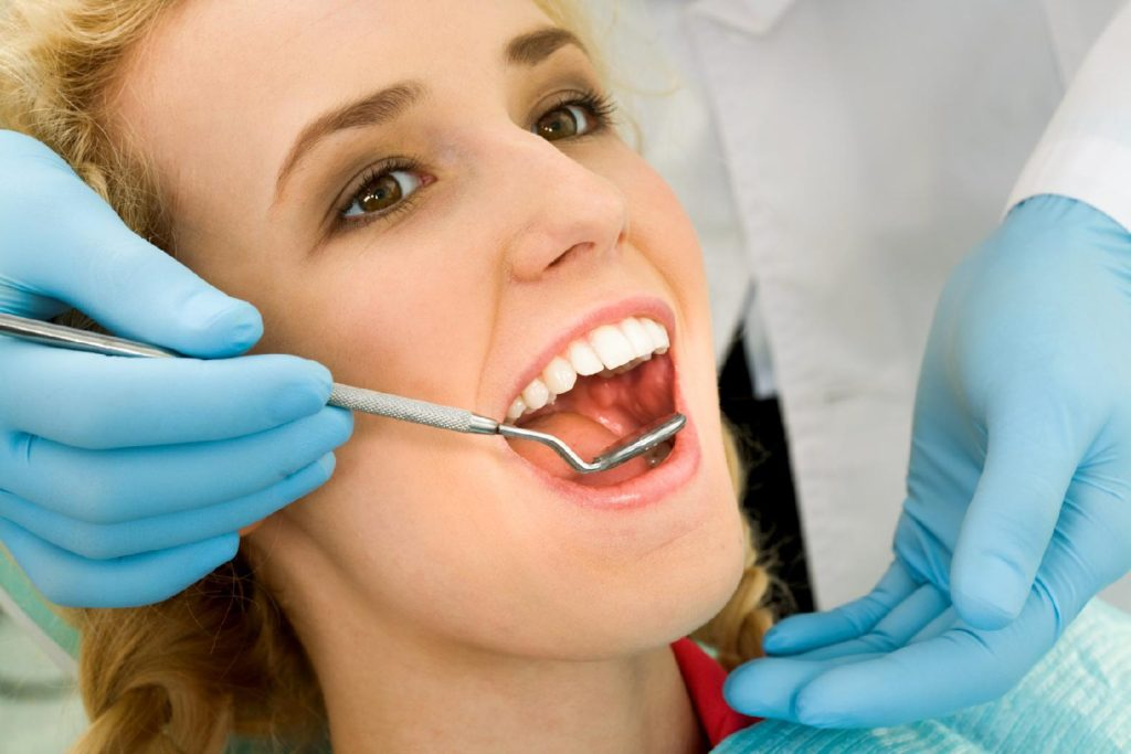 Maintain Your Oral Health With Regular Dental Check Ups Featured Image - Bowen Family Dentistry